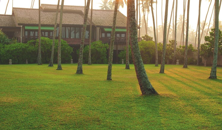 Reef Villa and Spa grounds, lawns, trees, hotel building in background