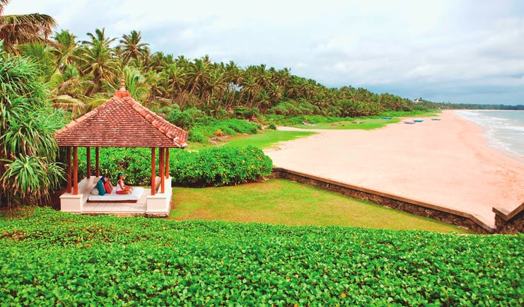 Saman Villas Sri Lanka beach sand palm trees meditation hut