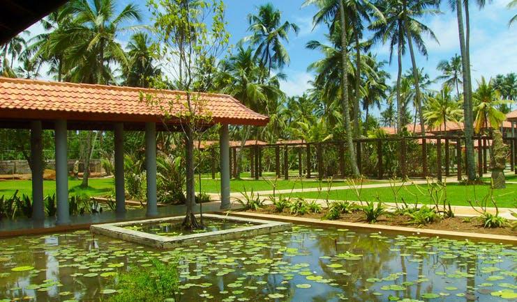Serene Pavilions Sri Lanka pond lawns palm trees