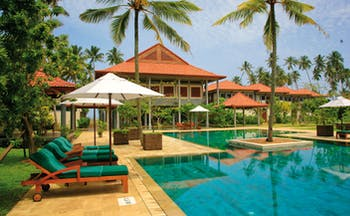Serene Pavilions Sri Lanka pool sun loungers umbrellas palm trees