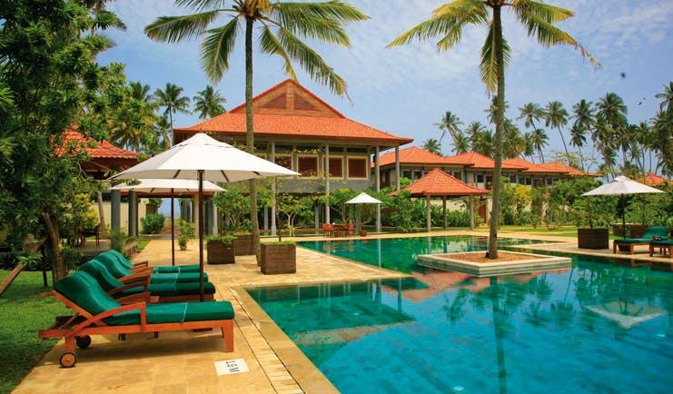 Serene Pavilions Sri Lanka pool sun loungers umbrellas palm trees