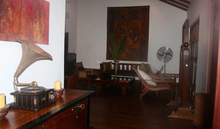 The River House Sri Lanka lounge gramophone chairs and artwork