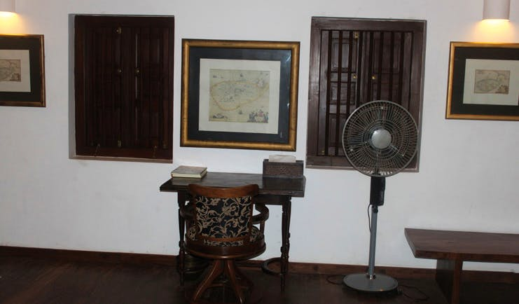 The River House Sri Lanka Menik suite desk and chair fan and wooden shuttered windows