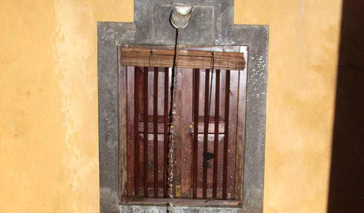 The River House Sri Lanka suite window with wooden shutters and bars