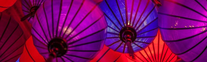 Purple, blue and red paper lanterns in Asia