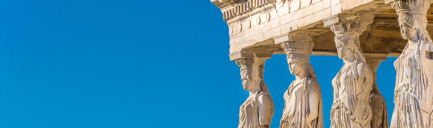 Ancient Greek caryatid statues supporting temple at Acropolis Athens